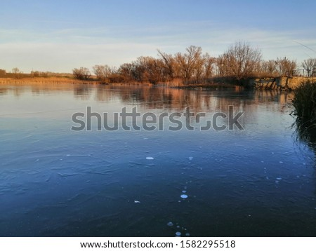 the shore of a frozen wild pond #1582295518