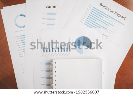 Business document report data with bar charts, pie charts, line graphs, on paper. Research data for market analysis and corporate financial planning. #1582356007