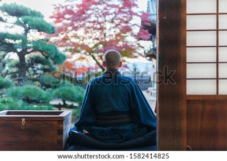 Japanese Buddhist Monk and autumn leaves #1582414825