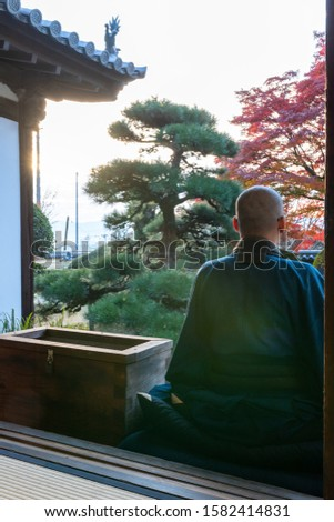 Japanese Buddhist Monk and autumn leaves #1582414831