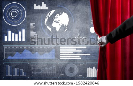 Hand opening red curtain and drawing business graphs and diagrams behind it #1582420846