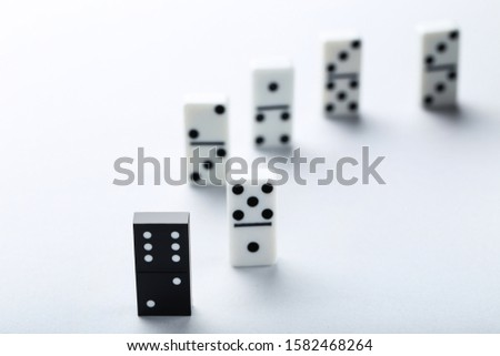 Leader concept. Domino tiles on grey background #1582468264