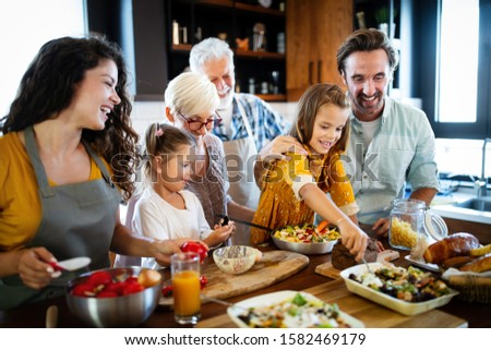 Grandparents, parents and children spending happy time in the kitchen #1582469179