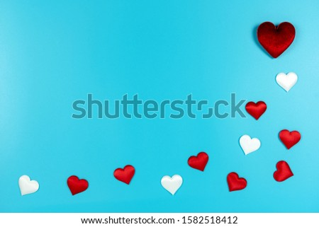 Love and Valentine's day concept., Decoration red hearts and white heart on light blue background with copy space for text. #1582518412