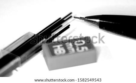 Pencil pencil and pencil sharpener on wallpaper paper #1582549543