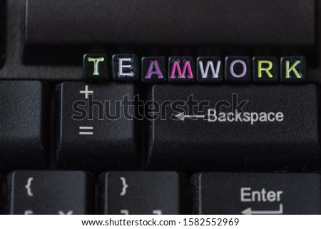 Teamwork word from blocks on keyboard close up. Team work concept. #1582552969