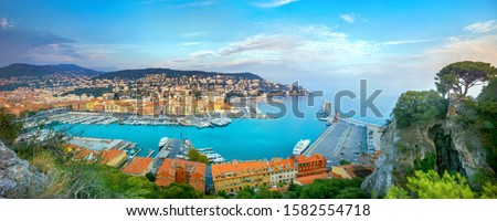 Panoramic view of Nice Old Port and coastal colorful houses from Castle Hill at sunset. Nice, France, Cote d'Azur, French Riviera