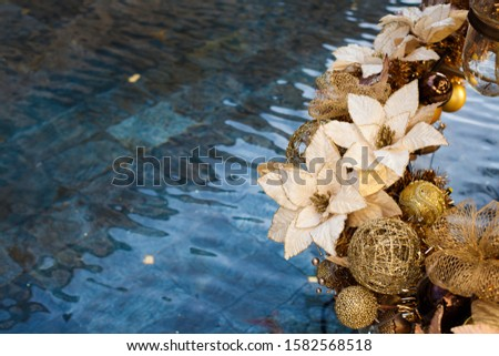 Christmas decoration. Christmas decoration аgainst the background of blue water. #1582568518