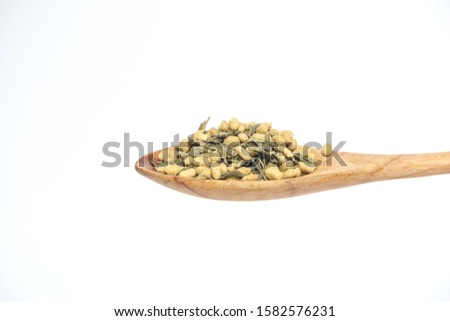 Cereal drink in the wooden spoon isolated on a white background. #1582576231
