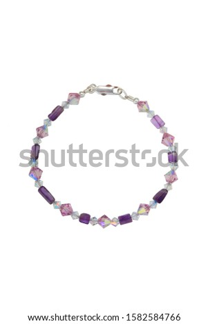 Irregular shape polished amethyst beads, bicone pink and clear dichroic crystals and silver findings make up this bead bracelet. Shown on a white background. #1582584766