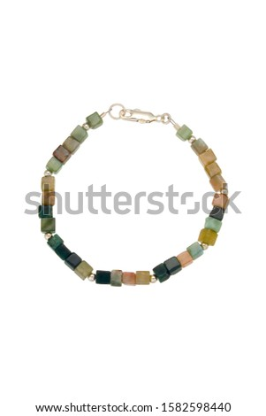 Varying colors of polished quartz cube beads and silver findings make up this bead bracelet. Shown on a white background. #1582598440