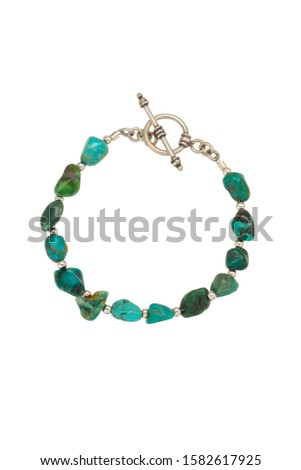 Irregular round polished shape turquoise beads and silver findings make up this bead bracelet. Shown on a white background. #1582617925