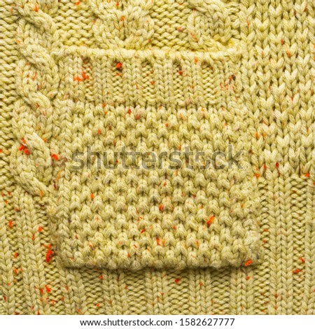 Knitted Pocket on a Knitted Sweater. Knitted Sweater Texture Close-Up View #1582627777