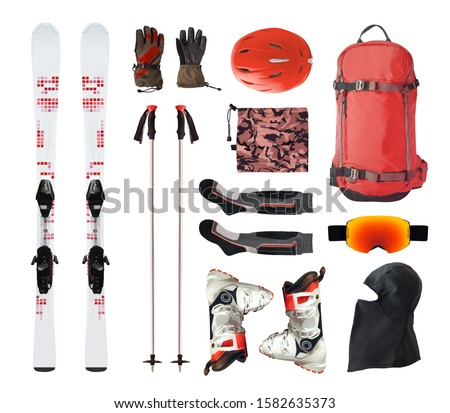 Flat lay of mountain ski equipment and alpine accessories. Helmet, boots, ski goggles, etc. isolated on white background #1582635373