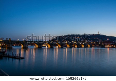 Charles Bridge is a historic bridge that crosses the Vltava river in Prague. #1582665172