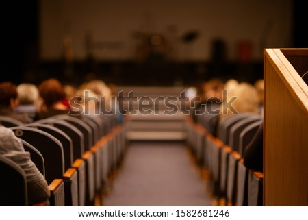 Blur defocus texture, background for design. Spectators in the theater sit on chairs before the performance #1582681246