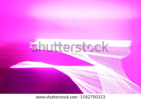 purple light graffiti in dark room #1582700323