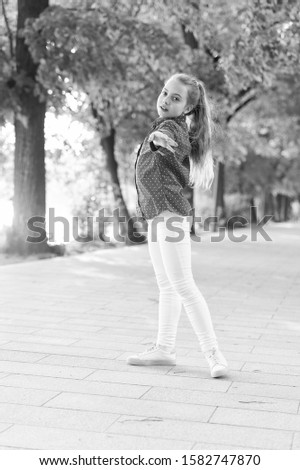 Girl carefree child. Summer holidays. Emotional kid nature background. Child care. Vacation time for relax. Positive emotions. Small girl relaxing in park. Little child enjoy walk park. Weekend time. #1582747870