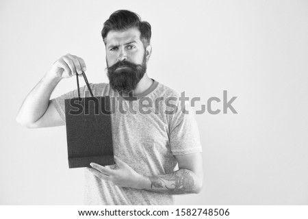Male motives for shopping appear to be more utilitarian. Aspects can influence customer decision making behavior. Hipster hold shopping bag. Man with purchase. Impulse purchase. Purchase concept. #1582748506