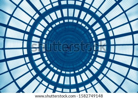 Double exposure of modern architecture fragments with concentric structure. Realistic though unreal transparent circular glass roof or ceiling. Abstract geometric background. Radial lines and sectors. #1582749148