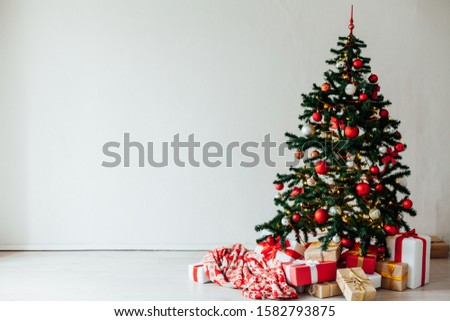 Christmas tree with gifts of red decor for the new year winter December