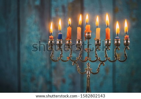 Jewish holiday, Holiday symbol Hanukkah Brightly Glowing Hanukkah Menorah soft focus #1582802143