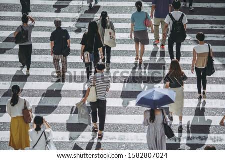 People crossing a pedestrian crossing #1582807024