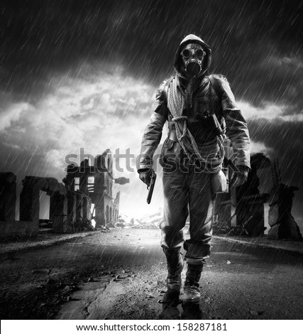 A lonely hero wearing gas mask walking through a city destroyed  #158287181