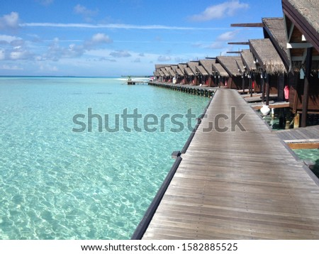 Overwater bungalows in a tropical paradise #1582885525