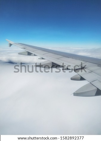 Airfoil and Cloudy Blue sky Royalty-Free Stock Photo #1582892377