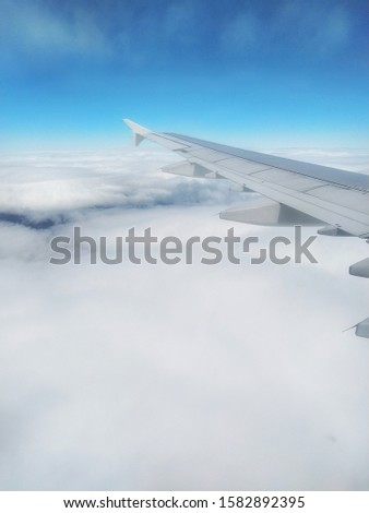 Airfoil and Cloudy Blue sky Royalty-Free Stock Photo #1582892395