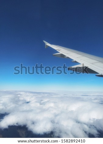 Airfoil and Cloudy Blue sky Royalty-Free Stock Photo #1582892410