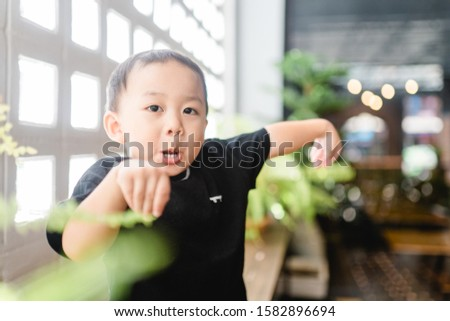 Happy funny Little asian baby boy child make funny pose and laughing: Healthy happy funny smiling face young adorable lovely kid.Joyful portrait of asian elementary preschool toddler boy.