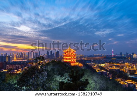 The yellow crane tower.Aerial view of  Wuhan city .Panoramic skyline and buildings beside yangtze river. Royalty-Free Stock Photo #1582910749