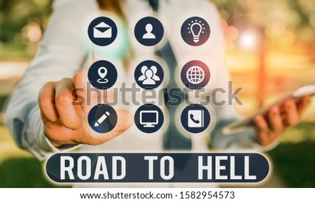 Text sign showing Road To Hell. Conceptual photo Extremely dangerous passageway Dark Ri Unsafe travel. #1582954573
