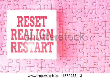 Text sign showing Reset Realign Restart. Conceptual photo Life audit will help you put things in perspectives Piece of square note paper use for give notation stick to puzzle background. #1582955113
