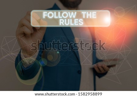Text sign showing Follow The Rules. Conceptual photo order someone stick to certain place country guides stricts. #1582958899
