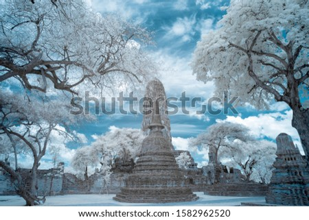 Ruined ancient Buddhist temple and pagoda in Autthya historical park, Thailand in infrared photography
