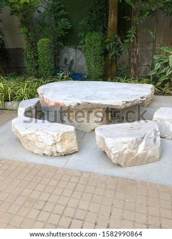 table and chairs made of stone #1582990864