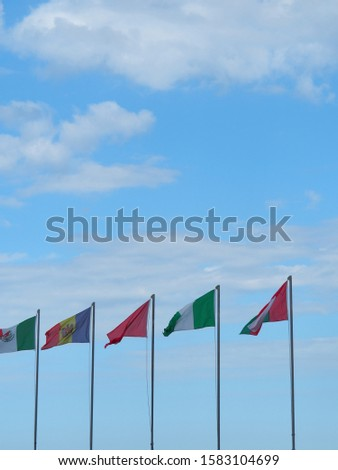 a row of country flags from various countries on metallic poles #1583104699