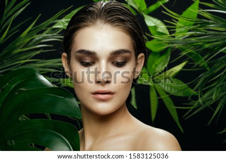 Beautiful woman charm naked shoulders green leaves cosmetology spa treatments #1583125036