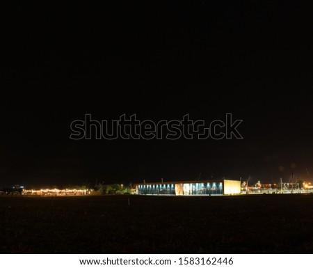 Szczecin. Night view from across the river to the illuminated historic center. Odra river. Chrobry embankments in Szczecin Royalty-Free Stock Photo #1583162446
