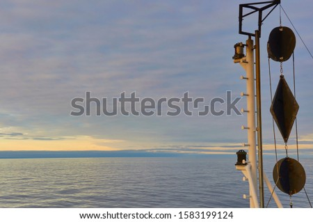 The Black Day Shapes showing a Vessels restricted movement on the head mast of a Vessel in the North Sea,. #1583199124