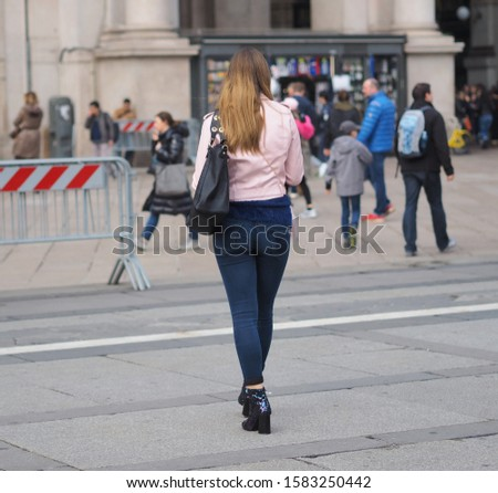 Woman in jeans Duomo square, Milan, Italy.