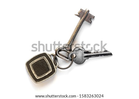 a combination of two keys with a keychain, a pendant for keys in the form of a black square with a silver frame - a place for placing an emblem, logo, advertisement on a white background with shadow.  #1583263024