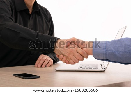 Good deal. Two confident business man shaking hands during a meeting in the office, success, dealing, greeting and partner concept. Close up view of business partnership handshake concept. #1583285506