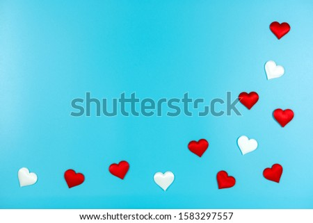 Love and Valentine's day concept., Decoration red hearts and white heart on light blue background with copy space for text. #1583297557