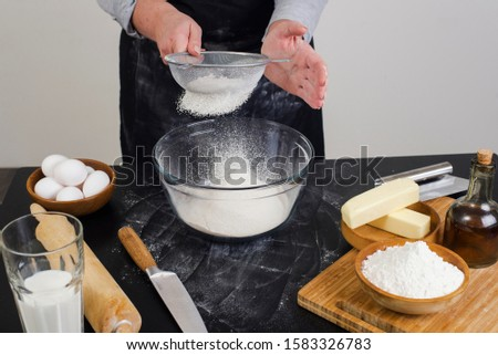 chef prepares the ingredients for making buns. dough preparation process. #1583326783