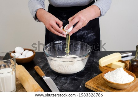 chef prepares the ingredients for making buns. dough preparation process. #1583326786