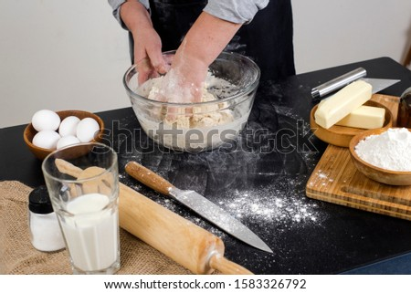 chef prepares the ingredients for making buns. dough preparation process. #1583326792